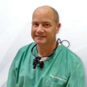 Photo of medical practitioner with SurgiTel loupes and LED headlights